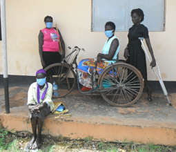 Mama Cave and her team of mask-makers in Gulu