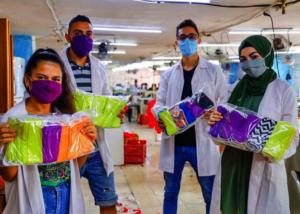 Anera's vocational training students sew masks