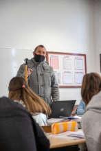 Mr. Canellari teaching with his new laptop