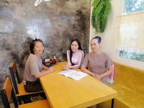 Warm Heart staff interviewing business owner