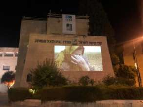 Amal Sumarin projected onto the JNF building