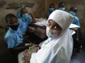 Female pupil in class