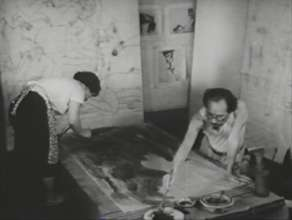 The Marukis painting the panels #1