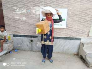 Woman with food packet