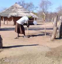 A Community Member Using a Tippy Tap