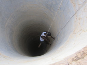 Entering the well in Santhie to rehabilitate it.