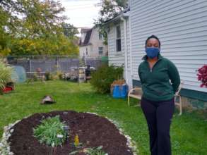 Detroit homeowner, with new rain garden