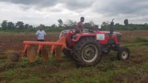 Inspecting a ploughing of a demostration farm