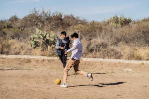 Children playing soccer at school