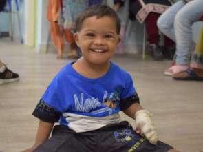 A child enjoying and beaming with joy at KDSP