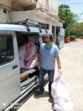 Delivering grocery bags to families' doorsteps