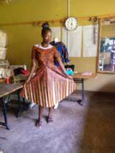 One of the women showing off her dress she made!