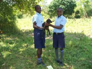 Martin and Moris show off their baby goat
