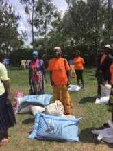 Widows receiving farm inputs