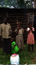 a family in the village recieving a food basket