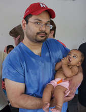 Dr. Aziz and a child he performed cleft surgery on