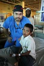 Dr. Aziz with patient after surgery