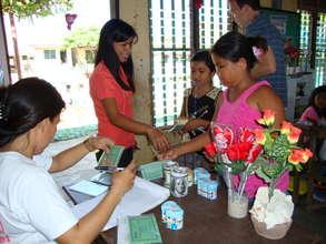 Children depositing to their savings account