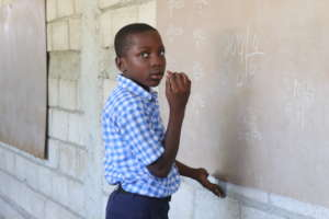 Student at Source Divine  Doing Division