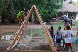 Children helping to build a playground in Mexico