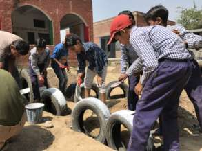 Building a playground with children help in India