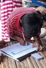 Child signing to receive school materials.