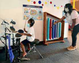 Music Exploration Corner, mom & son making music
