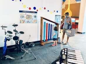Visitors enjoy the VICM music exploration corner