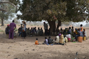 Villagers meet with BARKA under the tree
