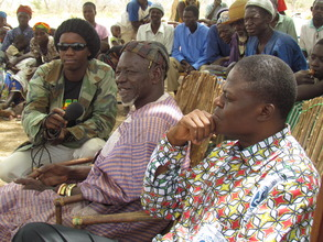 The local King and Prefect at a village meeting