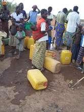 Women waiting for water, a daily ritual.