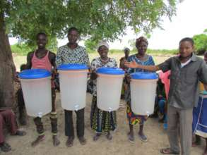Our first four filter customers in a village