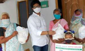 Project Leader distributing urgent food supplies