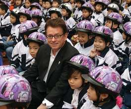 AIP Foundation President joins a helmet donation