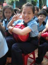 Student hugs her new helmet
