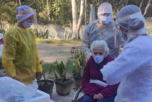Nurses taking care of an older adult in a LTCF