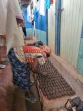 1 of our beneficiary preparing Briquettes to sell.