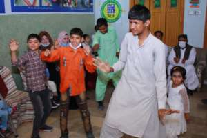 Children are dancing during the fun activity