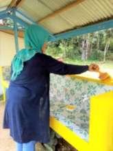 Teachers help paint wash facility