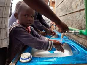 children washing their hand before taking a meal