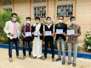 Holding the certificates in yard of institute