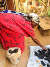 Older Woman Working on Briquettes