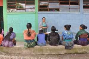 Participants listen to Sandy's presentation