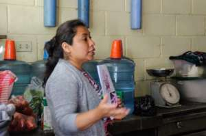 Nutrition educator Sandy leads a cooking workshop