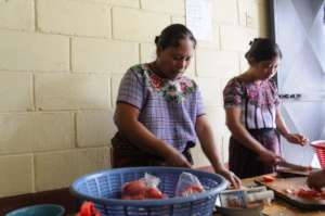 Mothers participate in a healthy cooking workshop