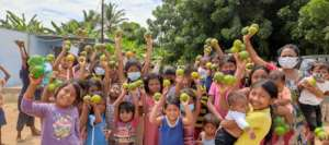 A group of children receving fruits