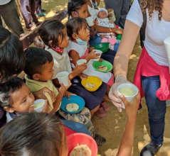 Giving food to children in communities