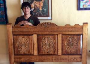 James with headboard he made in class.