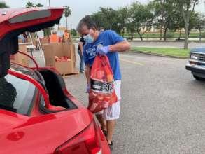 Volunteer Loads Emergency Food