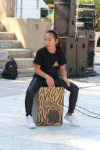 Young musician on her cajon